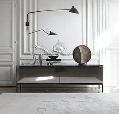 Beautiful combination of old and new. Love the Serge Mouille lamp.