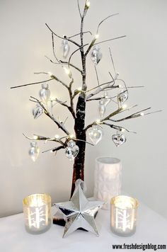 Even if you haven't got much space for a large Christmas tree, you can still create a seasonal atmosphere with a small tree. We love these birch winter effect trees, with their dusted snowy branches, and they're perfect to use for creating a Nordic style. Large Christmas Tree, Nordic Christmas, Outdoor Christmas, Christmas Design, All Things Christmas, Christmas Home, Christmas Tree Decorations, Christmas Holidays, Christmas Crafts
