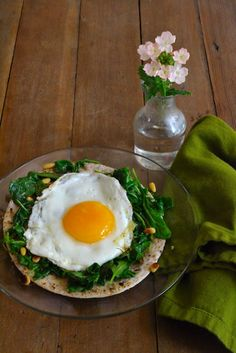 Wilted Arugula and Egg Pizza. Sauteed arugula, toasted pine nuts, creamy farm fresh egg on a rustic blue corn tortilla. Lean, clean and deliciously fresh! managedmacros.com