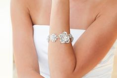 The ESTELLE bracelet is handcrafted with encrusted Swarovski Crystals in a floral style. This stunning bracelet epitomizes the integration of modern lu. Bridal Bracelet, Floral Style, Swarovski Crystals, Diamond Earrings, Wedding Rings, Engagement Rings, Bracelets, Handmade, Wedding Ideas