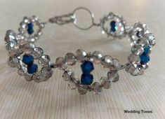 Handmade bracelet with grey and blue crystals creating an evil eye shape Handmade Wire, Handmade Bracelets, Eye Shapes, Blue Crystals, Crystal Bracelets, Evil Eye, Diamond Earrings, Grey, Jewelry