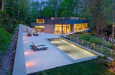 Designed in 2013 by Specht Harpman, this modern private residence is situated in Weston, Connecticut, United States.