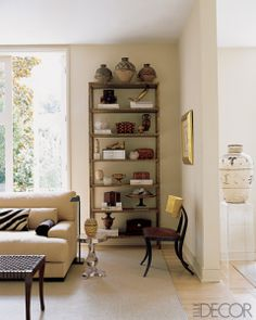 Think beyond the books, and create a freestanding gallery of meaningful objects and trinkets. Source: Elle Decor