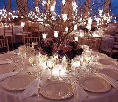 summer wedding ...flowers and tea lights on trees