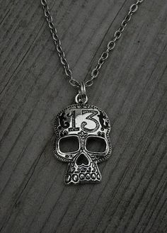 Skull and number 13 necklace.
