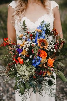 This Geode Boho Mountain Wedding Will Totally Rock Your Sock .- Natural bridal bouquet with bright colors and meadow flowers – wonderful for a romantic boho wedding - Fall Wedding Bouquets, Wedding Flower Arrangements, Autumn Wedding, Blue Wedding, Floral Wedding, Wedding Bride, Wildflower Wedding Bouquets, Blue Orange Weddings, Diy Wedding