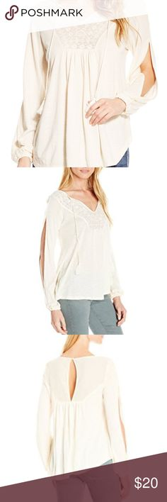 Jessica Simpson Tie Front Peasant Top Flowy and flattering, this peasant top features a dynamic tie front. Embroidered top detailing elevates the piece in style. You'll love the causal look and breezy feel of this must-have piece! Pullover V-neck Long set-in sleeves Jersey fabric Jessica Simpson Tops Tees - Long Sleeve