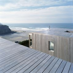 Porthtowan, Cornwall - Two passive solar gain houses by the Sea. Designed by the team at Simon Conder Associates, architects based in London and Suffolk. The houses make use of FSC sourced beautiful hardwood and have been designed with sustainability in mind. (Copyright Simon Conder. Photography credit Paul Smoothy) #SimonConder #Architecture #Domestic #Porthtowan #Cornwall