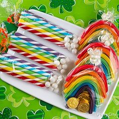 Gather a candy assortment of mini gumballs, candy sticks, Twizzlers and chocolate coins, then arrange them in clear pretzel bags and favor bags for sweet little packs of rainbows, clouds and leprechaun gold. Tie off the bags with curling ribbon and present to the lucky lads and lasses – they'll be over the rainbow for these packaged sweets!
