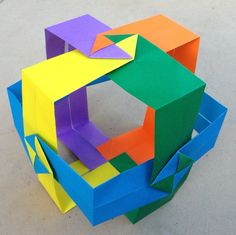 https://flic.kr/p/eaEshj   Origami Square cross modular (Dirk Eisner)   Well... I love this modular!  I don't think anyone has done this specific variation yet, so I did it:-). Later on I'd like to try folding a waterbomb base on each of the edges!  Huge thanks to Dirk Eisner for sharing diagrams. :-)