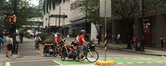 I have spotted many tourists towing children and babies with rented bikes on the separated bike lanes - such as this group, in the heart of Vancouver at the intersection of the Hornby and Dunsmuir separated bike lanes. The amazing evolution of Vancouver bike lanes