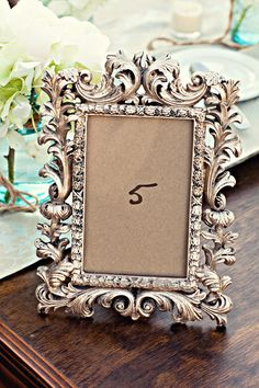 Simple framed table numbers.