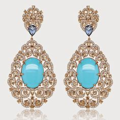 Sutra brought color to the party with exceptional gemstones and creative designs as with these turquoise, diamond and gold earrings.