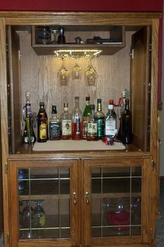 My cousin converted her old entertainment center into a bar! How cool! … My cousin converted her old entertainment. Old Entertainment Centers, Diy Entertainment Center, Repurposed Furniture, Diy Furniture, Furniture Refinishing, Furniture Projects, Wood Projects, Anderson Freire, Armoire Bar