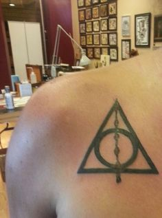 """Deathly Hallows tattoo """"The last enemy that shall be destroyed is death""""~Potters' Grave stone """"You are the true master of death, because the true master does not seek to run away from Death. He accepts that he must die, and understands that there are far, far worse things in the living world than dying."""" ~Albus Dumbledore to Harry Potter"""