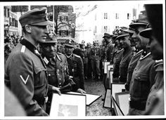 Police skiing competitions in Innsbruck. Heydrich, chief of the Security Police and SD, at the presentation of the winners prizes. 04.03.1941.