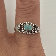Sterling Silver Flower Ring With Stabilized Turquoise Stone