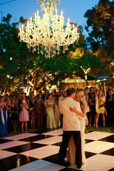 Checkered dance floor. huge chandelier.