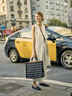 Get the Look: Zara Long Waistcoat ($70), Flowing Culottes ($40), and Striped Tote ($50).