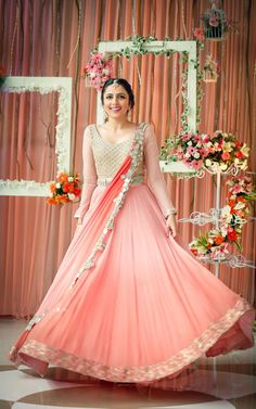 Looking for Bride in Peach and Silver Engagement Lehenga? Browse of latest bridal photos, lehenga & jewelry designs, decor ideas, etc. on WedMeGood Gallery. Indian Engagement Outfit, Engagement Gowns, Indian Gowns Dresses, Indian Outfits, Bride Dresses, Reception Gown, Wedding Reception, Anarkali Gown, Anarkali Suits