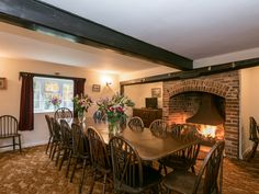 This large farmhouse boasts a magnificent, cosy open fire in the dining room. Cosy Lounge, Interior Decorating, Decorating Ideas, Country Interiors, Dining Room, Dining Table, Open Fireplace, Log Burner, Open Fires