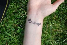 Courage on her wrist