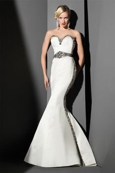 Strapless fit and flare gown with black, silver, & smoke embroidered tuxedo beading belted waist