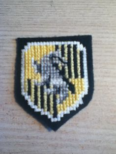 Finished my Hufflepuff badge!! My fingers hurt. It looks great!