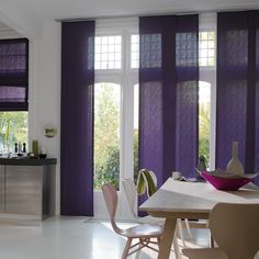 Floor to ceiling Panel Track blinds add style and colour to this this open plan kitchen.   #luxaflex #blinds #home decor #purple