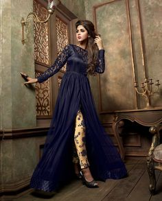 Blue and beige front slit suit with embellished border 1. Blue and beige georgette silk net front slit suit2. Floral printed bottom3. Comes with matching bottom and dupatta4. Can be stitched upto size 44 inches