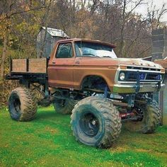 Crazy lifted For pickup with a flatbed that has built in wood sides