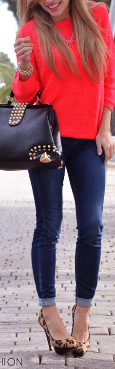 Cuffed skinny jeans, bright top, heels