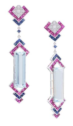 A PAIR OF ART DECO STYLE AQUAMARINE, RUBY, SAPPHIRE AND DIAMOND DROP EARRINGS. Featuring rectangular step cut aquamarines totalling 16.78cts, bordered by sapphires and rubies, suspended from a sapphire, ruby and diamond set fitting, mounted in 18ct white gold.
