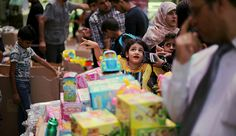 Palestinians shop in a market ahead of the holy month of Ramadan, in Khan Yunis in the southern Gaza Strip, June 17, 2015.