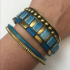 "Blue & Gold Bangles - set of 5 Blue and golden resin bangles, in goldtone. Set of 5.  Various widths .25""-.5"" Jewelry Bracelets"