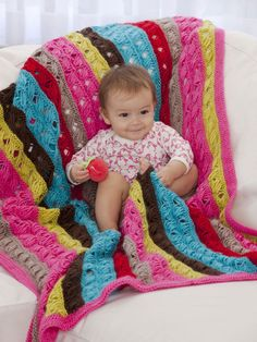 """Wishing I knew how to knit right now... """"Modern Love(y)"""" blanket/throw designed by Vickie Howell for Caron."""