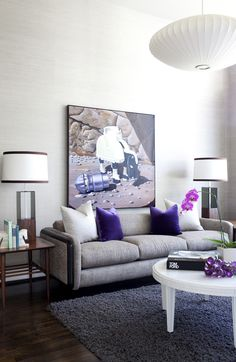 Various hues of purple and lighting in the living room.