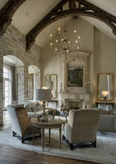 love the stone wall and wood beams