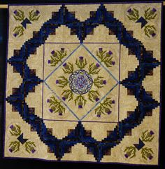 """The Magic of Skye"" by Hanne Asbey from Aberdeen (Scotland).Thistle applique with Celtic center.  2014 Festival of Quilts, photo by Kameleon Quilt"