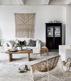 No one does an effortless, boho-style summer quite like Indie Home Collective . Natural materials, woven accents, striking photographic art...