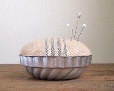 This pincushion would be a nice way to display old jewelry pins & broaches. Jello Mold Pincushion - Rustic Cotton Blue Stripe.