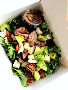 salad with spinach, kale, arugula, fresh mozz, pecans, tomatoes, cucumbers, dried cranberries, avocado and flak steak