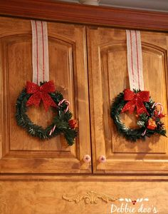ribbon on kitchen cabnets | Dollar store Christmas wreaths in the kitchen - Debbiedoo's