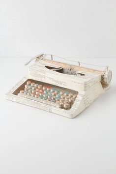 Don't know where you get one, or how to make one - but gotta have it!!!! Vintage Paper Typewriter