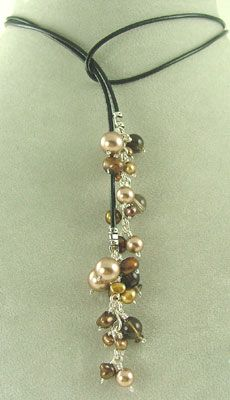 Mocha Lariat Necklace Lariat Necklace is handcrafted with Greek Leather and ends with handcrafted Sterling Silver Scrolls holding Champagne Swarovski Crystal Pearls, dark Smoky Quartz Gemstones, Chocolate and Gold Freshwater Pearls. Please note, the loop of the Lariat Necklace will be less prominent with wear and body heat. Beaded Lariat Necklace: 35 inches long