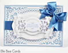 An updated look to my previous Christening card design, shown in blue for a bouncing baby boy!  The card is made using multiple layers of Spellbinders die-cut shapes and Tattered Lace embossing folders - which creates a simple, delicate but heavy, luxurious Christening card which can also be made with a keepsake box.