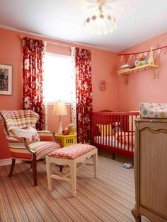 The crib in this nursery was spray-painted a vivid red for an inexpensive update to the space. The light fixture casts a pattern on the ceiling for a whimsical touch, and the beautiful drapes add a textural element.