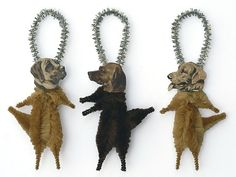 Decorate your feather tree, Christmas tree, or pegboard with this set of three chenille dog ornaments. They also make great gifts, and come packaged in a clear cellophane bag tied with a bow - ready to gift or to embellish your gift box or card. These three little chenille dog ornaments are handmade and designed by Old World Primitives. Each dog ornament is about 5 inches tall from the top of the silver hanger to the bottom of their toes. They are made of chenille, reproduction vintage…