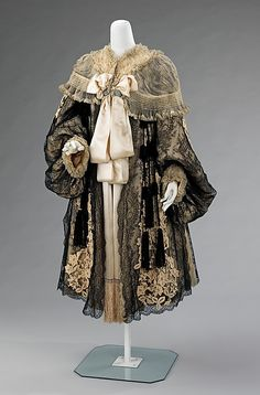 Evening coat, 1895-1905, Rouff (French, 1844–1914). This evening coat with distinctive oversized sleeves exemplifies work by the House of Rouff, a premiere couture house in the late-19th to early-20th century. Known for the lingerie feel of their garments, Rouff always decorated with a multitude of ruffles & laces.