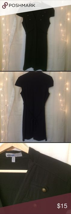 Mid-thigh black, cotton dress A dress for any occasion! It has a slim tie around the waist which connects to the front buttons. There are brass colored buttons on the breast of the dress. Very breathable fabric, lots of stretch, hits about mid thigh. Dresses